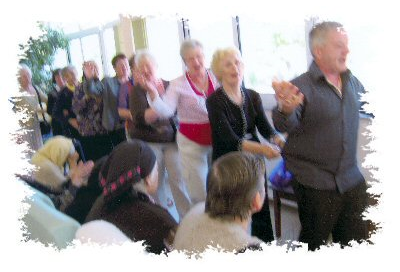 After Mass, pilgrims enjoying a sing a long with the residents.