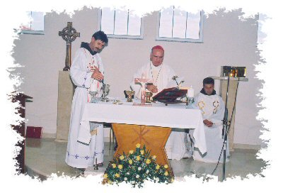Bishop Ratko of Mostar consecrates <br />the altar and celebrates Holy Mass at the Home.